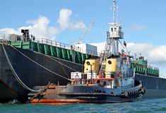 Fuel Barge and Tug Stock Image