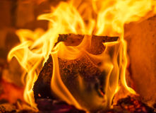 Fuel briquette in a fireplac Stock Photo