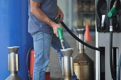 Fuel canister. At gas station Royalty Free Stock Image