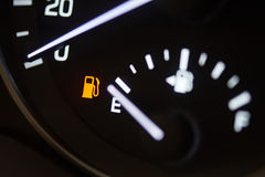 Fuel consumption theme. Empty tank indicator on car dashboard Stock Photo
