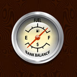 Fuel Cost. A humorous fuel gauge on a wooden dashboard Stock Images