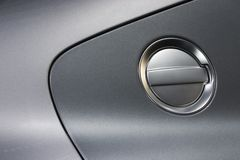 Fuel Cup. Detail of a silver luxury car Royalty Free Stock Photo