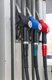 Fuel dispenser with pistols at the gas station. Fuel dispenser with 3 pistols at the gas station Royalty Free Stock Image