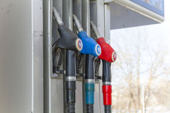 Fuel dispenser with pistols at the gas station. Fuel dispenser with 3 pistols at the gas station Royalty Free Stock Photos