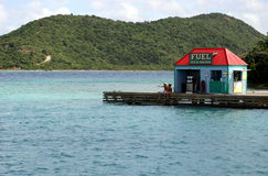 Fuel dock. At Marina Cay in the British Virgin Islands with hillside stock photos