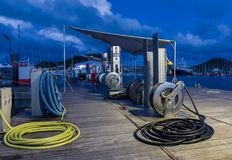 Fuel dock marina at night in Le Marin, Martinique. Sailboats in background, dark blue sky Stock Images