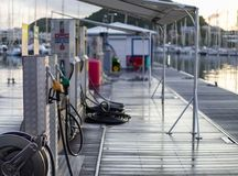 Fuel dock marina at sunrise in Le Marin, Martinique. Sailboats in background Royalty Free Stock Images
