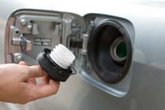 Fuel filler cap in male hand Royalty Free Stock Image