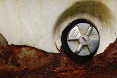 Fuel gas cap. Of a rusty white car Royalty Free Stock Photography