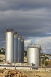 Fuel or gas storage tanks at harbour Stock Image