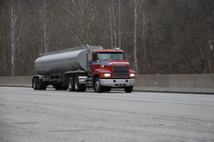 Fuel or Gas Tanker Truck. On the highway Stock Photo