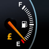 Fuel Gauge. Showing Pounds warning light stock photos