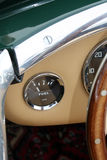 Fuel gauge of classic British sports car. Interior detail in dashboard of classic British sports car Royalty Free Stock Image
