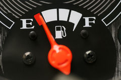 Fuel gauge with warning indicating low fuel tank. Royalty Free Stock Image