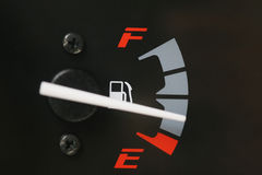 Fuel gauge with warning indicating low fuel tank. Royalty Free Stock Photos