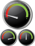 Fuel gauges. Silver fuel gauges with needle at empty full and half full Stock Photography