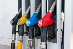 Fuel guns at a gas station. Close up stock photos