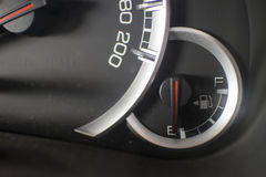 A fuel level their display stands on empty. Royalty Free Stock Photography