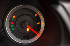 Fuel meter on empty position Stock Photos