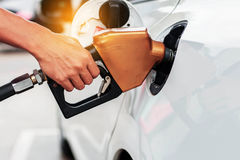 Fuel nozzle on cars. Stock Image