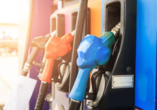 Fuel nozzle dispensing pump at gas station. Stock Photo