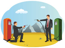 Fuel nozzle duel. Business people are pointing fuel nozzle at each other like a duel. Competition in the oil industry Stock Photography