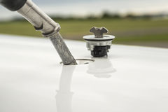 Fuel nozzle filling up aircraft Stock Photo