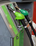 Fuel nozzle at a gas station Royalty Free Stock Images
