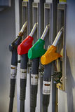 Fuel nozzle at a gas station Stock Photography