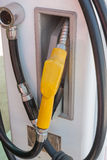 Fuel nozzle at a gas station. Stock Images