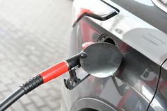 Fuel nozzle in the gas tank of a car close-up photo. Gas station Refueling concept. copispeis stock image