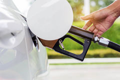 The fuel nozzle inside a car. Stock Images