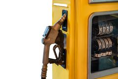 Fuel nozzle lock on yellow petrol pump on background. Fuel nozzle lock on yellow petrol pump on white background royalty free stock photos