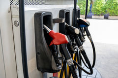 Fuel nozzle pay for fuel and benzyl. Royalty Free Stock Photo