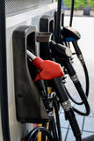 Fuel nozzle pay for fuel and benzyl. Royalty Free Stock Image