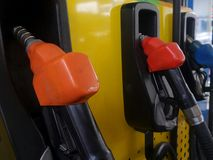 Fuel nozzle in petrol tank. Fuel nozzle in petrol station royalty free stock photo
