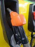 Fuel nozzle in petrol tank. Fuel nozzle in petrol station stock image