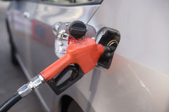 Fuel nozzle during refueling Royalty Free Stock Photo