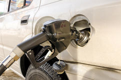 Fuel nozzle in the tank at the gas station. Royalty Free Stock Image