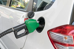 Fuel nozzle to add fuel in car at gas station Royalty Free Stock Images