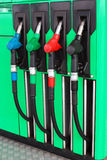 Fuel nozzles at gas station.  royalty free stock photography