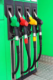 Fuel nozzles at gas station Stock Images