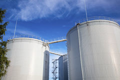 Fuel, oil tanks against blue sky Royalty Free Stock Photo