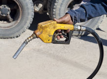 Fuel pistol. Old fuel pistol in a hand of the worker Stock Image