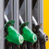 Fuel pistols on fuel station. Fuel pistols on fuel station in winter Royalty Free Stock Photo