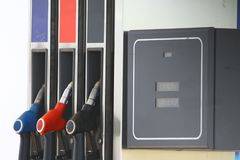 Fuel pistols gas pump nozzles on fuel station and the fuel meter. Fuel pistols gas pump nozzles on fuel station Royalty Free Stock Image