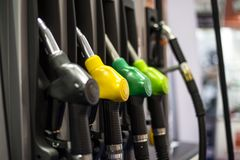 Fuel pistols on the petrol station. Closeup of the fuel pistols on the petrol station royalty free stock image