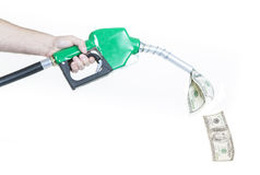Fuel Prices. A man holding a green gasoline nozzle with money spilling out Royalty Free Stock Photos