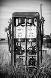 Fuel Pump. Older style petrol / gasoline pump stands next to a field Stock Images