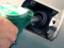 Fuel pump. Close up of a hand putting gasoline in a car Stock Images